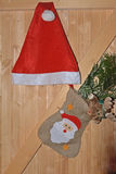 Traditional Santa Claus hat. On a wooden background Stock Images