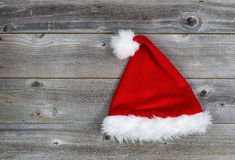 Traditional Santa Hat on Rustic Wood Royalty Free Stock Photography