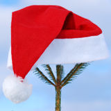 Traditional Santa hat on winter Stock Photos
