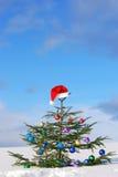 Traditional Santa hat on winter Stock Photo