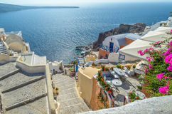 Traditional Santorini's rocky architecture, with beautiful view on caldera Royalty Free Stock Images
