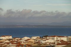 View of the roofs of a country in Sardinia with a varied sky in layers that generates a pleasant visual effect royalty free stock photos