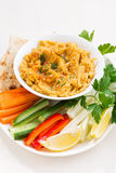 Traditional sauce hummus with fresh vegetables and pita bread Royalty Free Stock Images