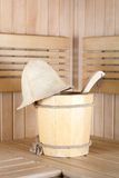 Traditional sauna for relaxation with bucket of water Royalty Free Stock Photos