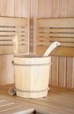 Traditional sauna for relaxation with bucket of water Royalty Free Stock Photography