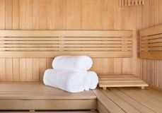 Traditional sauna for relaxation with set of clean towels. Traditional wooden sauna for relaxation with set of clean towels Stock Photography