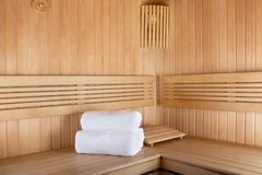 Traditional sauna for relaxation with set of clean towels. Traditional wooden sauna for relaxation with set of clean towels Royalty Free Stock Photo