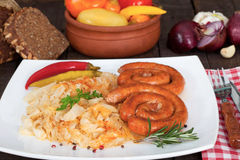 Traditional sausage and sauerkraut Stock Photography