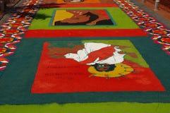 Traditional Sawdust carpet religous festival Honduras 2018. In Comayagua Honduras a Sawdust colored carpet on a traditional festival with religous images royalty free stock photos