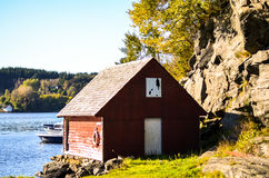 Traditional scandinavia falun red wooden house at fjord Royalty Free Stock Image
