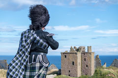 Traditional scottish bagpiper in full dress Royalty Free Stock Images