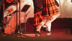 Traditional scottish band musicians singing with bagpipes and drums on the stage Royalty Free Stock Image