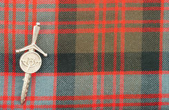 Traditional Scottish Donald Clan Tartan Wool Fabric. Traditional Scottish MacDonald clan pattern tartan wool fabric royalty free stock photos
