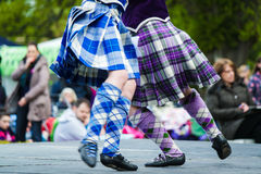 Traditional scottish Highland dancing in kilts. At the highland games stock image