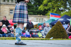 Traditional scottish Highland dancing in kilts. At the highland games royalty free stock photo