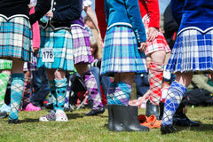 Traditional scottish Highland dancing in kilts. At the highland games royalty free stock images
