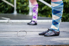 Traditional scottish Highland dancing in kilts. At the highland games stock images