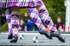 Traditional scottish Highland dancing in kilts. At the highland games royalty free stock photography