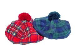 Traditional Scottish Red and Green Tartan Bonnets. Traditional Scottish Green and Red Tartan Bonnet, also named Tam o' Shanter. Men headgear Isolated on white Royalty Free Stock Photos
