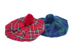 Traditional Scottish Red and Green Tartan Bonnets. Traditional Scottish Green and Red Tartan Bonnet, also named Tam o' Shanter. Men headgear Isolated on white Stock Image