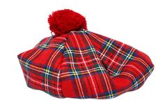 Traditional Scottish Red Tartan Bonnet. Traditional Scottish Red Tartan Bonnet, also named Tam o' Shanter. Men headgear Isolated on white Background Royalty Free Stock Images