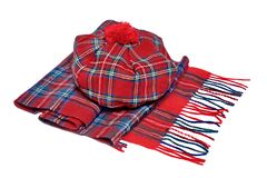 Traditional Scottish Red Tartan Bonnet and Scarf. Men headgear and neckwear Isolated on white Background Royalty Free Stock Photography