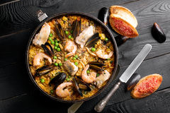 Traditional seafood paella in the pan Royalty Free Stock Images