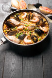 Traditional seafood paella in the pan Royalty Free Stock Photo