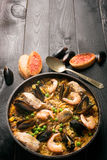 Traditional seafood paella in the pan Stock Images