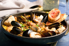 Traditional seafood paella in the pan Royalty Free Stock Image