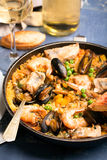 Traditional seafood paella in the pan Royalty Free Stock Photos