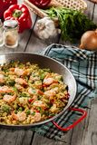 Traditional seafood paella with shrimp, fish and chicken seved i. N paellera. Spanish cuisine. Top view Royalty Free Stock Photo