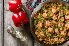 Traditional seafood paella with shrimp, fish and chicken seved i. N paellera. Spanish cuisine. Top view Royalty Free Stock Photography