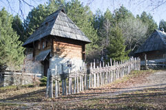 Traditional serbian house. Serbian traditional rural house behind wooden fence royalty free stock photography