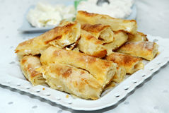 Traditional Serbian pie with cheese on a white plate. stock images
