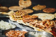 Traditional serbian street food burger or pljeskavica, flatbread and meat. Freshly Serbian burger, called pljeskavica and meat, traditional Serbian street food stock image