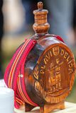 Traditional Serbian Wood Bottle. With the inscription `Blue Delicates` and used for a beverage made of plum royalty free stock images