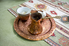 Traditional serving of Turkish coffee. With traditional delight in background Stock Photo