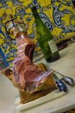 Traditional sevillan ham and wine in a restaurant Stock Photo