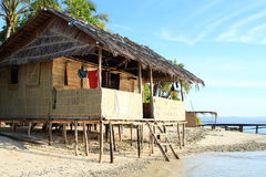 Traditional shack. Traditional indonesian shack by sea made from wood, bamboo and palm leaves - homestay in touristic village Arborek (Raja Ampat, Papua Barat Royalty Free Stock Photo