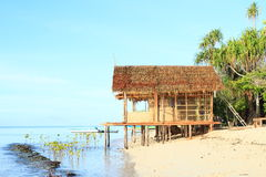 Traditional shack. Traditional indonesian shack by sea made from wood, bamboo and palm leaves - homestay in touristic village Arborek (Raja Ampat, Papua Barat Stock Photo
