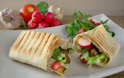 Traditional shawarma wrap with chicken and vegetables.  Royalty Free Stock Image