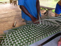 Traditional sheet braiding for a shelter creation. Stock Photos