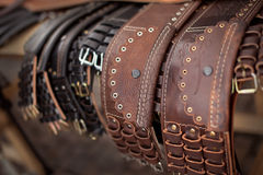 Traditional shepherd belt. Variety of broad traditional romanian belts Royalty Free Stock Photo