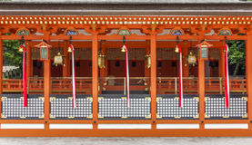 Traditional shinto architecture and stone lanterns at Fushimi In Royalty Free Stock Photos