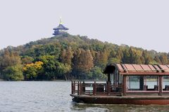 Traditional ship on the West lake, Hangzhou, China. Traditional boat at the West Lake (Xihu)  near Hangzhou in China. At the background a pagoda Stock Photography