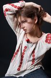 Traditional shirt. Country girl in traditional blouse with red flowers Royalty Free Stock Image