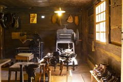 Traditional shoemaker workshop with tools Stock Images