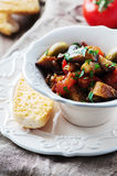 Traditional sicilian dish caponata with eggplant and tomato Royalty Free Stock Photography