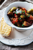 Traditional sicilian dish caponata with eggplant and tomato Stock Photo